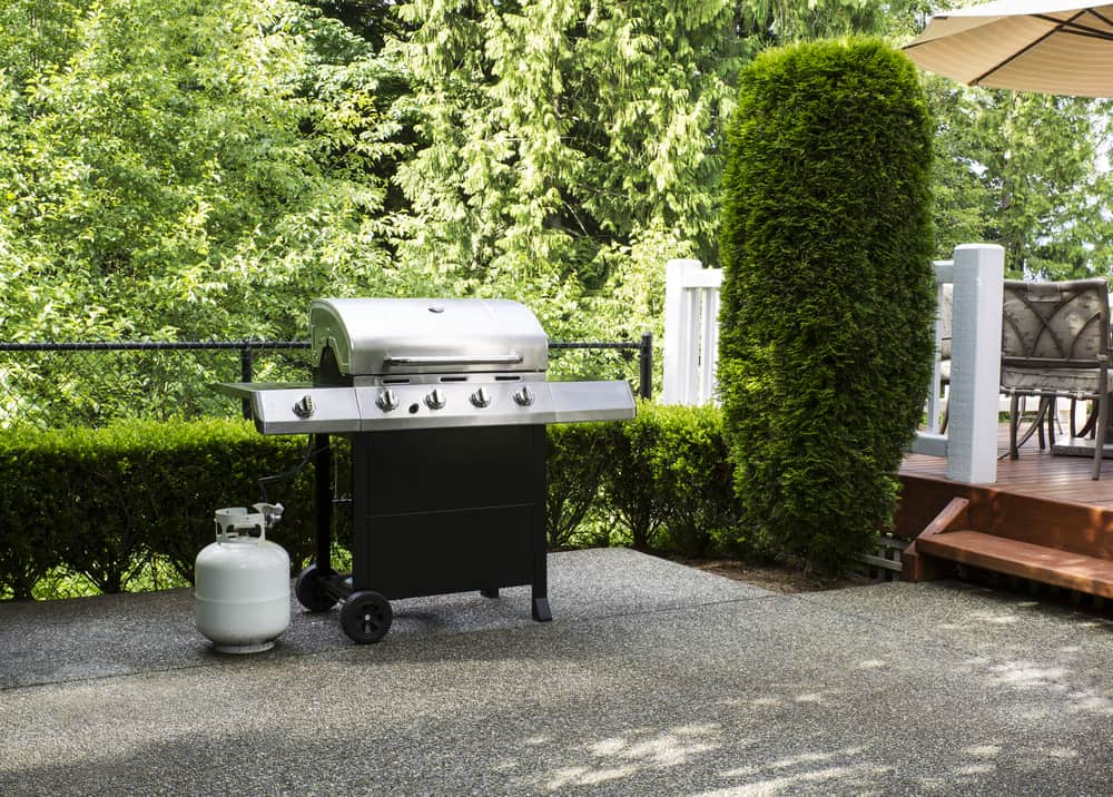 large barbeque cooker on concrete outdoor patio