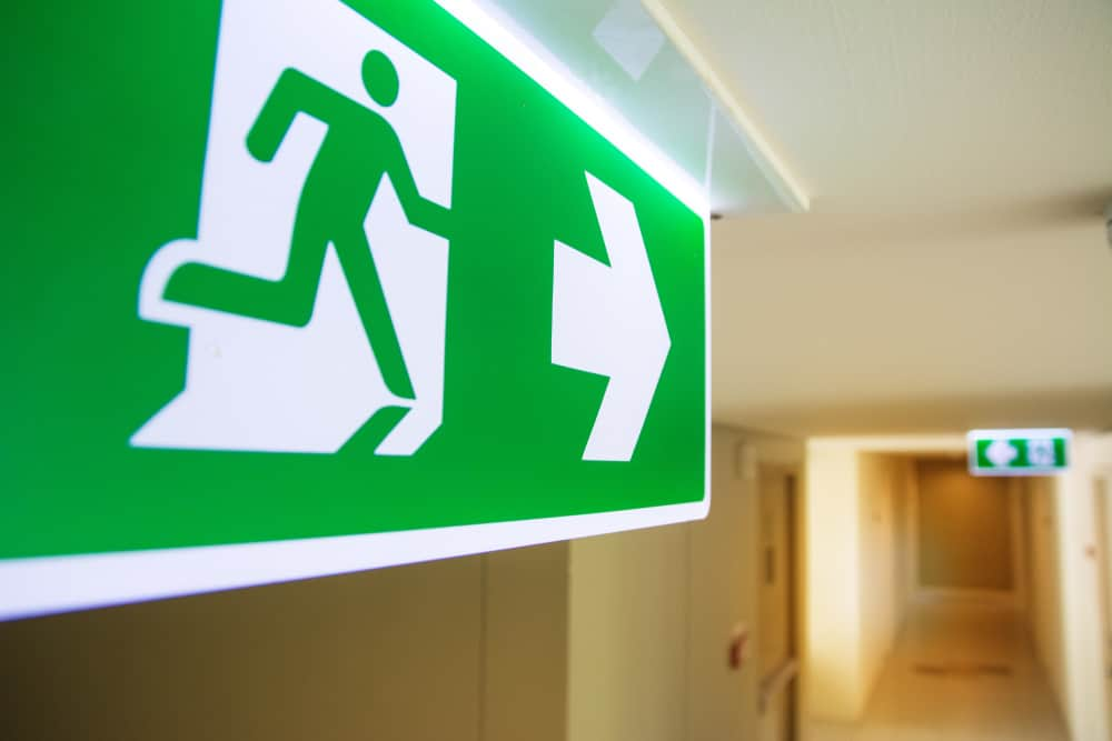 Emergency Fire Exit Sign Strategically Placed at the Corridor of a Building